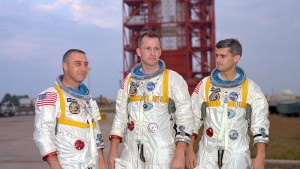 Grissom, White, and Chaffee in front of the launch pad.