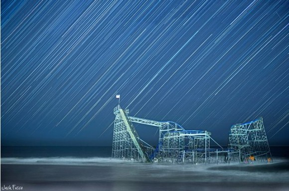 Stars streak over the Jet Star rollercoaster in Seaside Heights, New Jersey, as it awaits removal from the Atlantic Ocean. Credit and copyright: Jack Fusco.